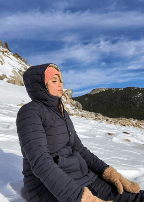 woman meditating in the snow